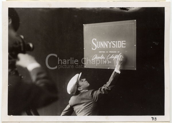 Chaplin signing the title card for Sunnyside