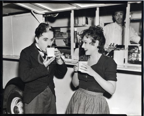 Chaplin and Paulette Goddard having tea on the set of The Great Dictator