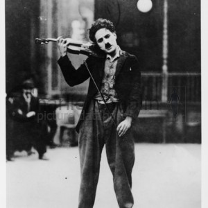 Chaplin playing violin midsquare
