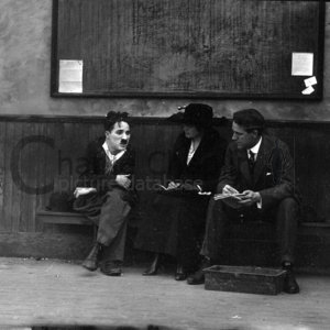 Chaplin on dog s life set with journalists midsquare