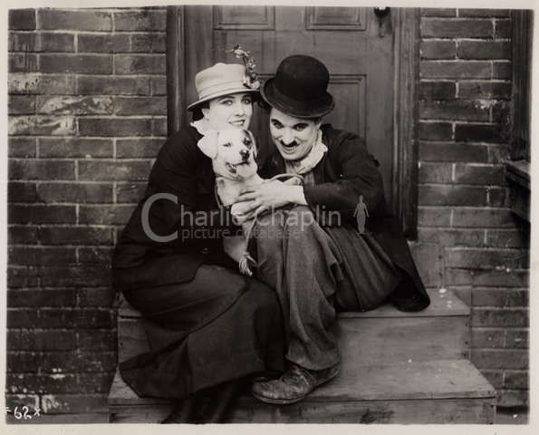 Edna Purviance, Mutt and Charlie Chaplin in a publicity still for A Dog's Life