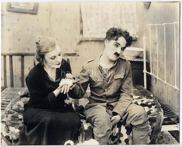 Shoulder Arms publicity still with Edna Purviance and Charlie Chaplin