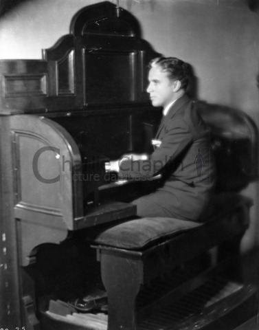 Chaplin playing the organ