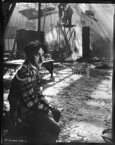 Chaplin on the set of The Circus after a fire raged through the studio during the ninth month of shooting, destroying sets and props.