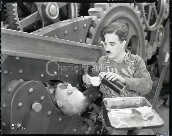 Mechanic caught in the machinery - Charlie Chaplin Image Bank