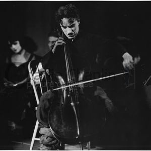 Chaplin playing cello midsquare