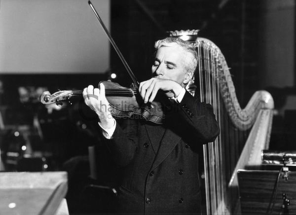 Chaplin playing violin and harp big