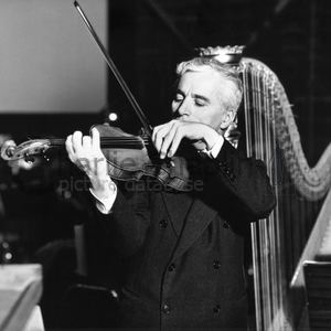 Chaplin playing violin and harp midsquare