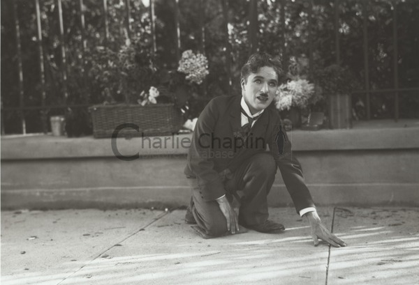 Chaplin directing Cherrill by acting the part of the blind girl, showing her what he wanted her to do