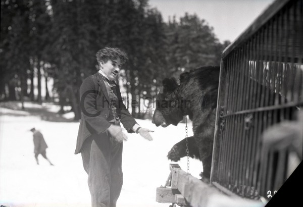 Chaplin with a bear on location in Truckee, California during the shoot