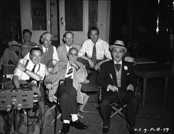 Robert Florey (front left), Wheeler Dryden (back, left of center), Henry Bergman (front center), Rollie Totheroh (back right), and Chaplin (front right) with crew members on the set of Monsieur Verdoux