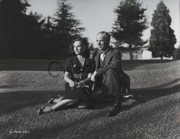 Paulette Goddard & Chaplin at his Beverly Hills home, 1936