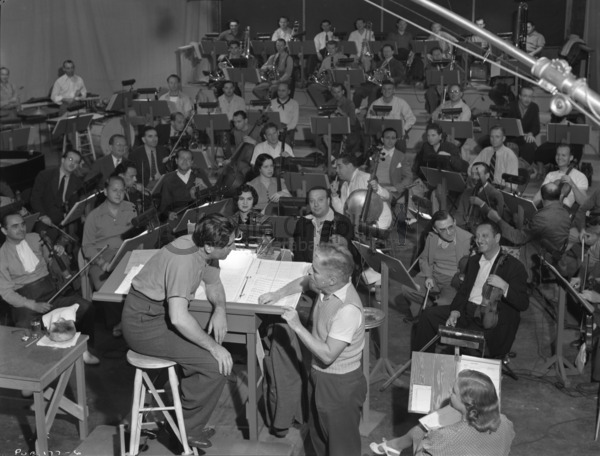 Chaplin and Meredith Wilson rehearsing with musicians for The Great Dictator