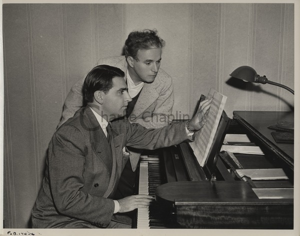 Charles Chaplin working with Meredith Willson on the music for The Great Dictator