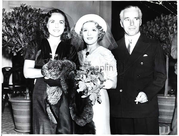 Paulette Goddard, Mary Pickford and Charles Chaplin at Pickford's wedding to Buddy Rogers, 1937