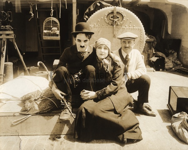 Charlie Chaplin, Edna Purviance and Charlie's brother Sydney on the set of The Immigrant (1917)