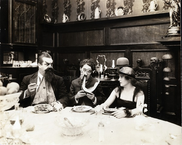 Eric Cambell, Charlie Chaplin and Edna Purviance in The Count, 1916