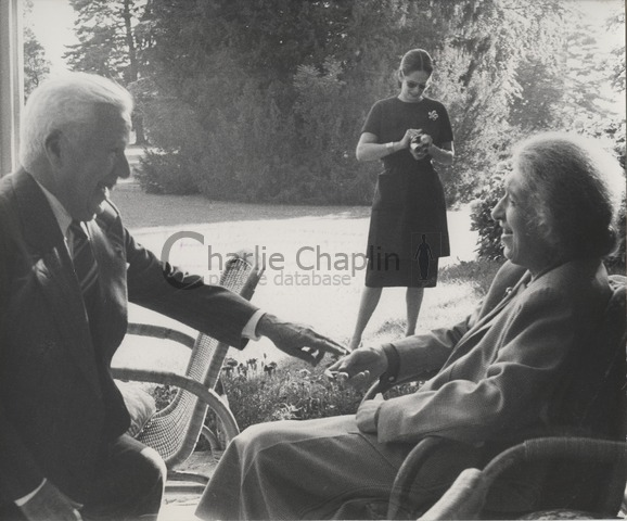 Charles Chaplin, Oona Chaplin (background) and pianist Clara Haskil at the Chaplin family home in Switzerland, the Manoir de Ban