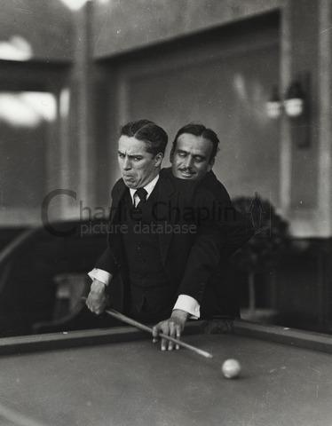 Douglas Fairbanks, Edward Knoblock and Charles Chaplin playing pool -  Charlie Chaplin Image Bank
