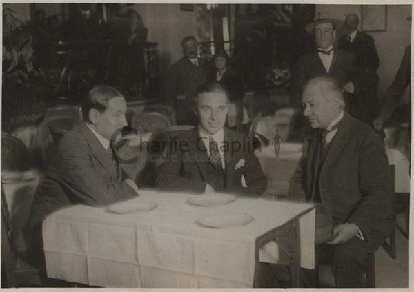 Chaplin (center) met with French cartoonist, Cami (left) at the Hotel Claridge in Paris, 1921