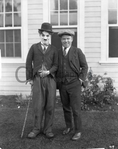 "Charles Chaplin and Jim Tully during filming of ""The Gold Rush"""
