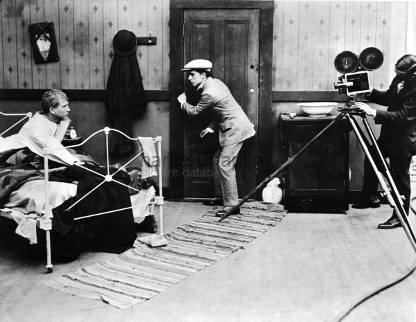 Tom Wilson, Charles Chaplin and Roland Totheroh on the set