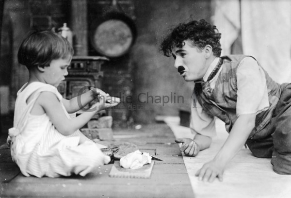 Jackie Coogan and Charlie Chaplin on the set of The Kid