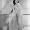 Paulette Goddard with white coat