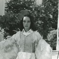 Victoria Chaplin in the garden wearing wings