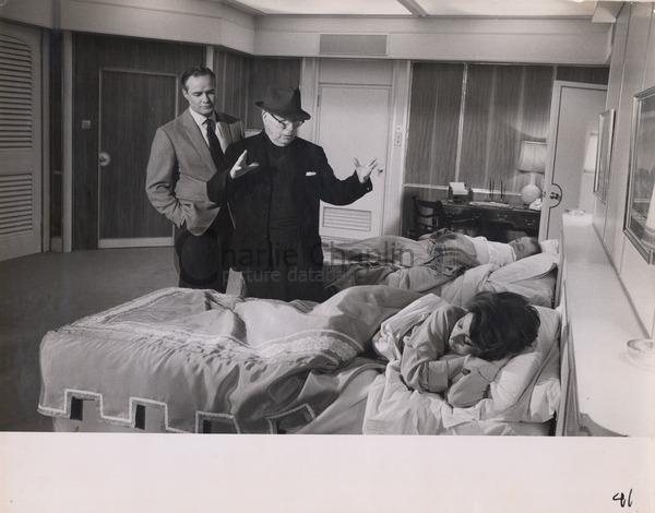 Charlie Chaplin directing Marlon Brando and Sophia Loren