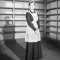 Joan Barry in dark dress and apron