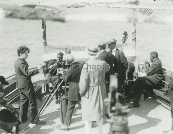 Chaplin (left) directing A Day's Pleasure on a pleasure boat he rented