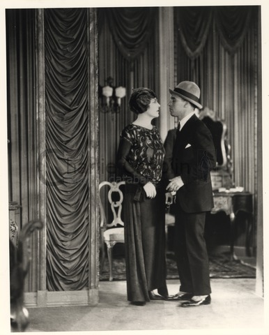 Chaplin directing Edna Purviance in A Woman of Paris