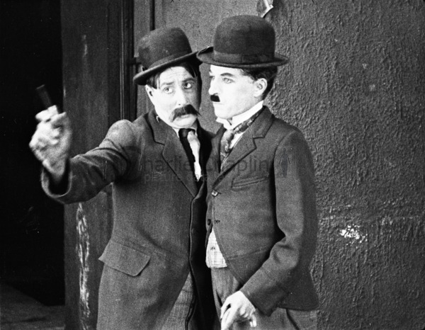 Sydney (Charlie's brother) and Charlie Chaplin in Pay Day (1922)