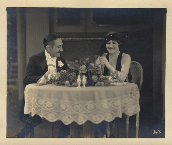 Adolphe Menjou and Edna Purviance