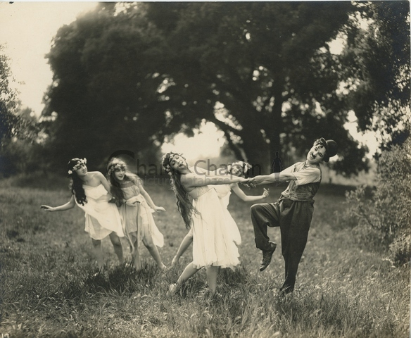 Chaplin dancing with the wood nymphs in Sunnyside