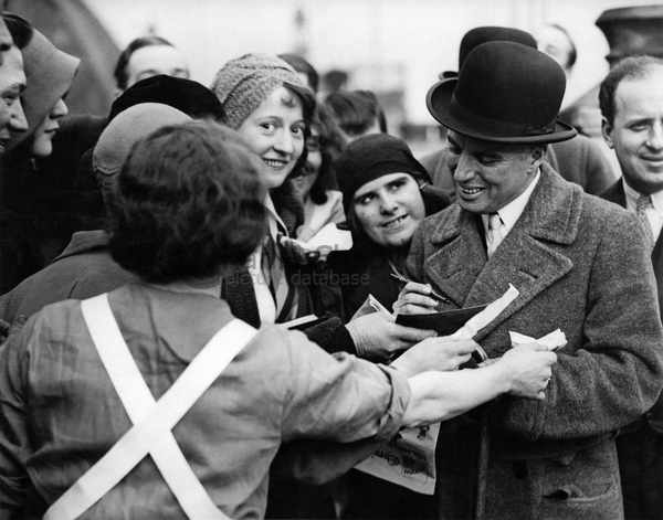 Cc in london signing autographs for carlton hotel staff. feb 19  1931 big