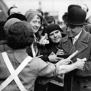Cc in london signing autographs for carlton hotel staff. feb 19  1931 midsquare