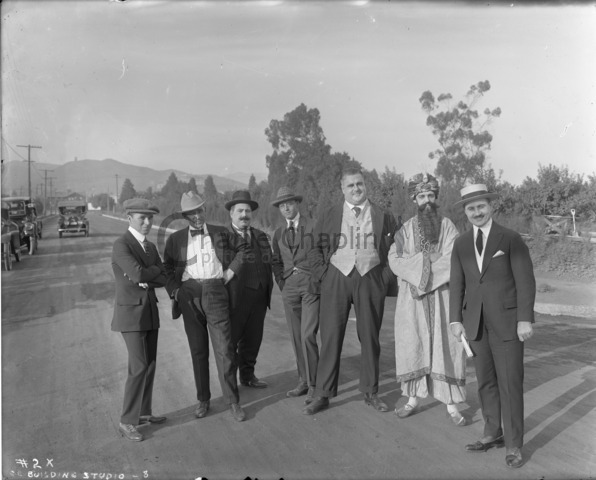 Left to right: Charles Chaplin, John Jasper, Henry Bergman, Carlyle Robinson, Eric Campbell, Albert Austin (in costume for How to Make Movies) and Sydney Chaplin during construction of Chaplin Studios